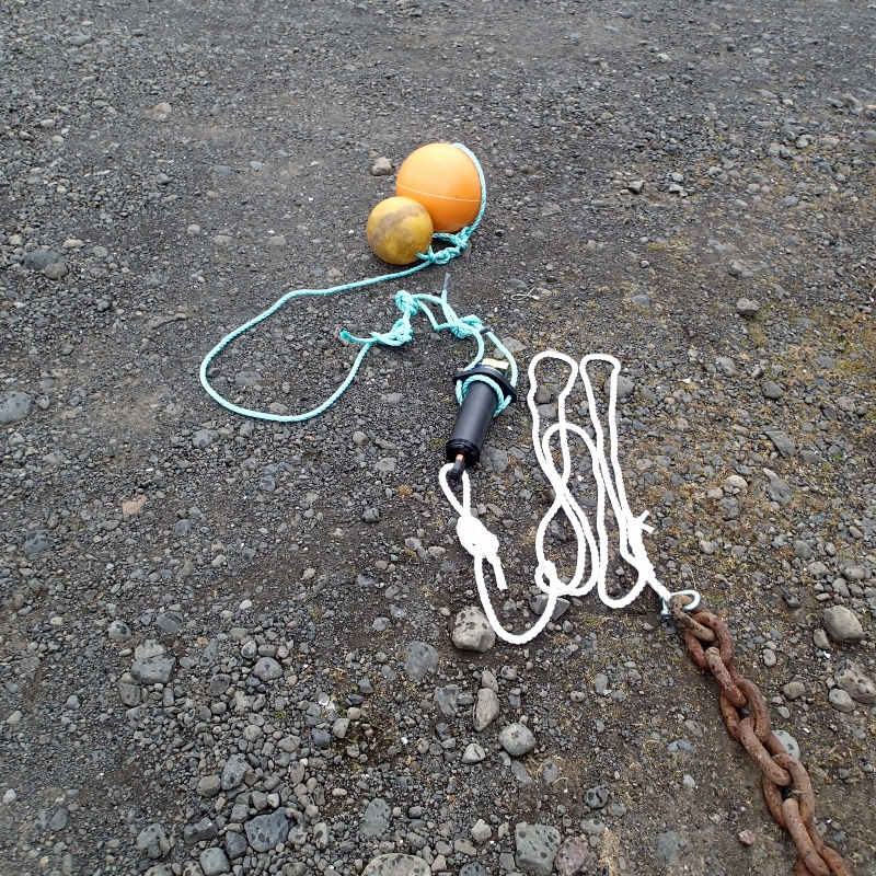A hydrophone attached to an anchor and two floating balls.